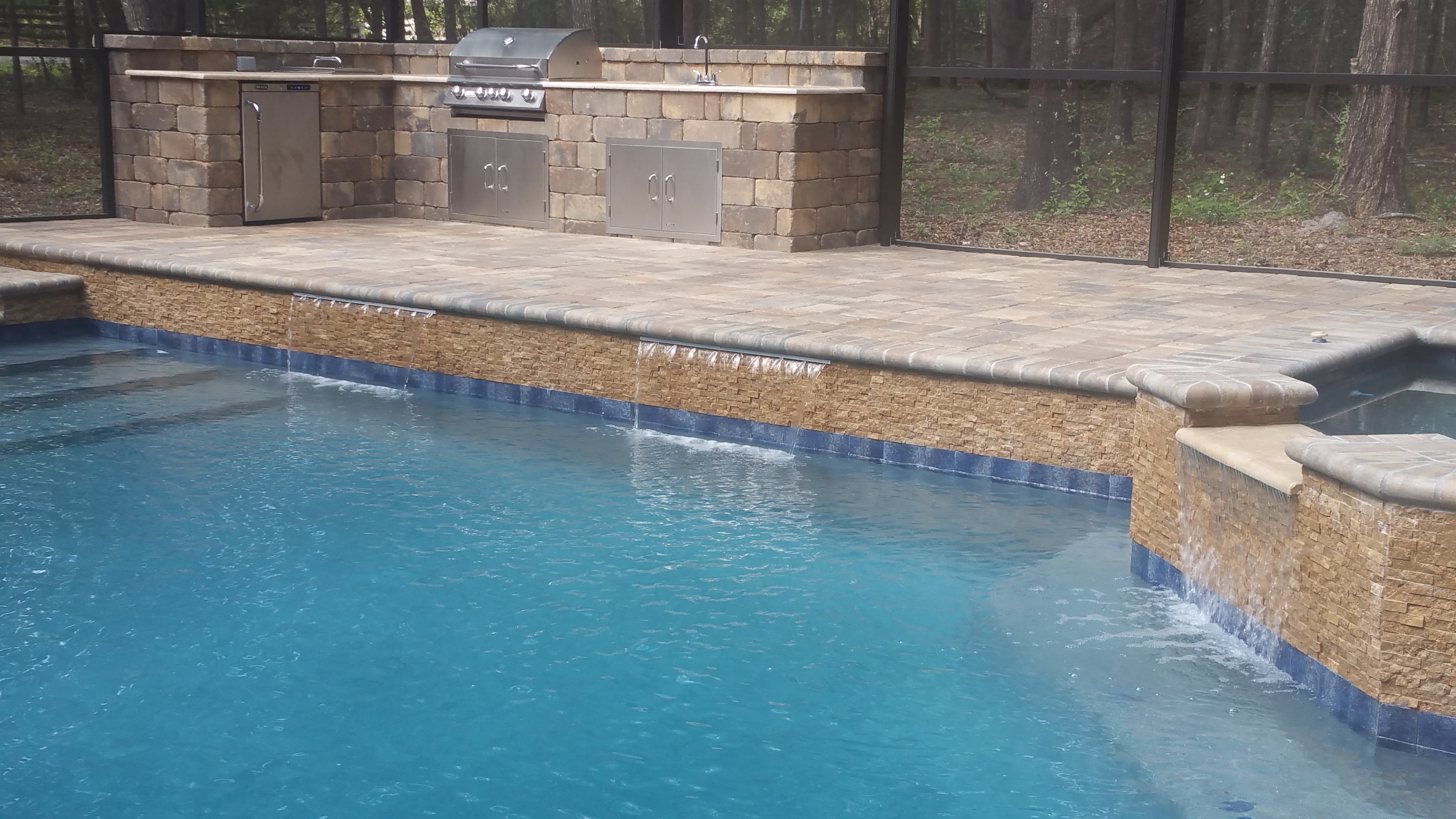 Concrete Pool Deck with Outdoor Kitchen