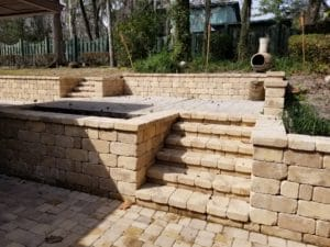 Concrete paver retaining wall by FloridaScapes