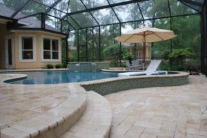 Pool deck made of travertine pavers by FlroidaScapes