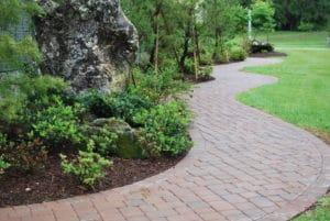 Landscape Design featuring concrete pavers by FloridaScapes