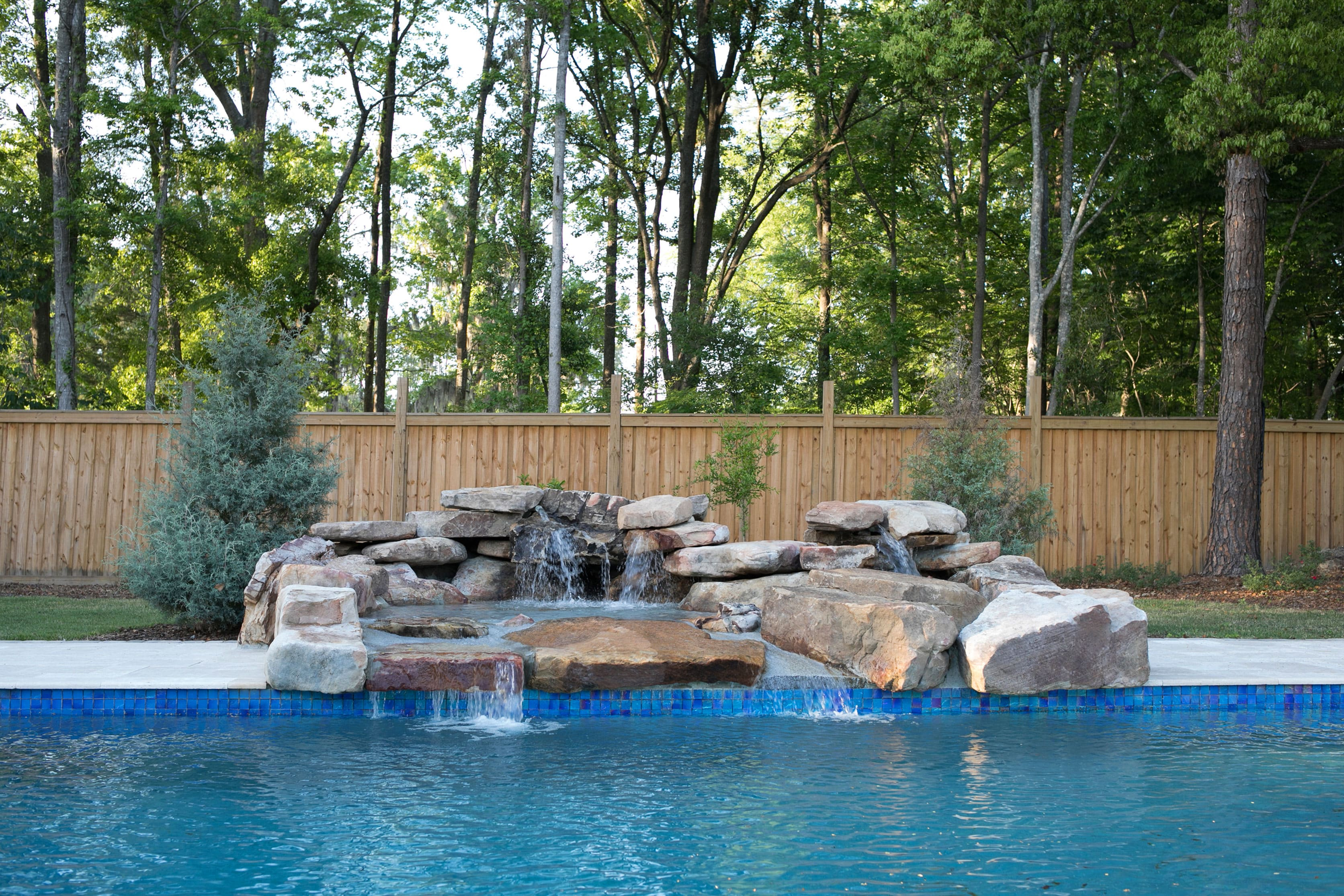 Pool Deck with Natural Stone Waterfall
