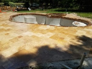 remodeled pool deck with paver tiles